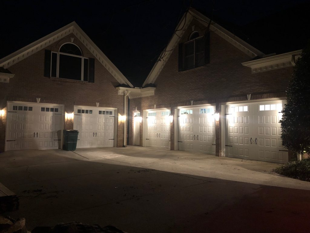 garage doors lit up at night