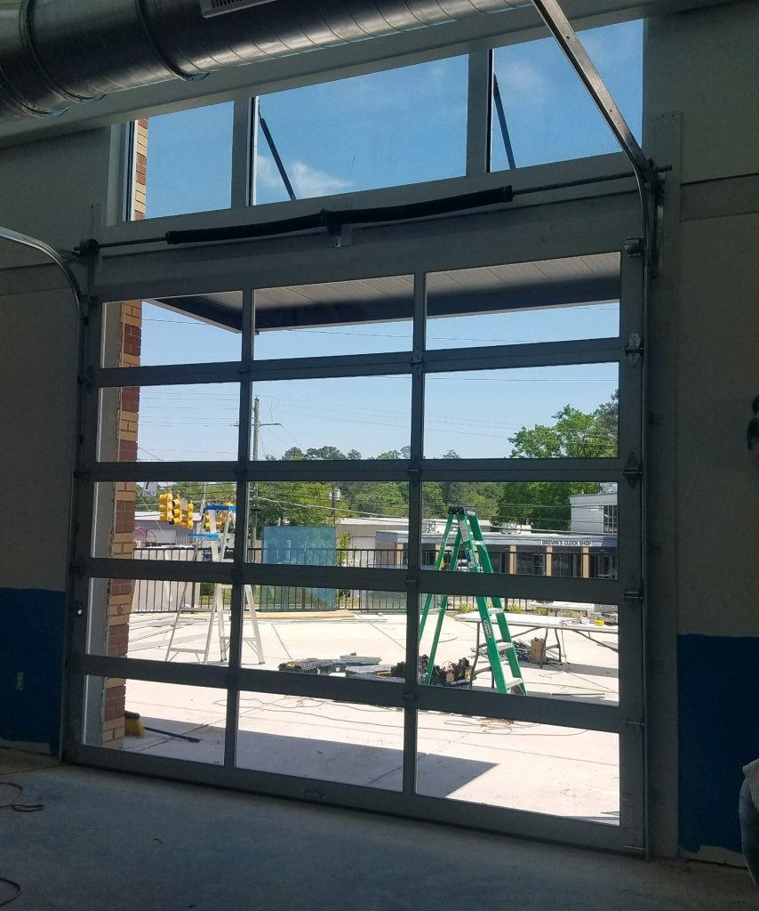 Interior view of full view glass commercial garage door in Raleigh, NC