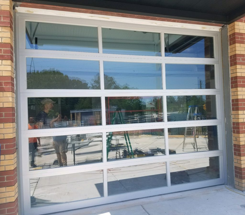Exterior view of full view glass commercial garage door in Raleigh, NC