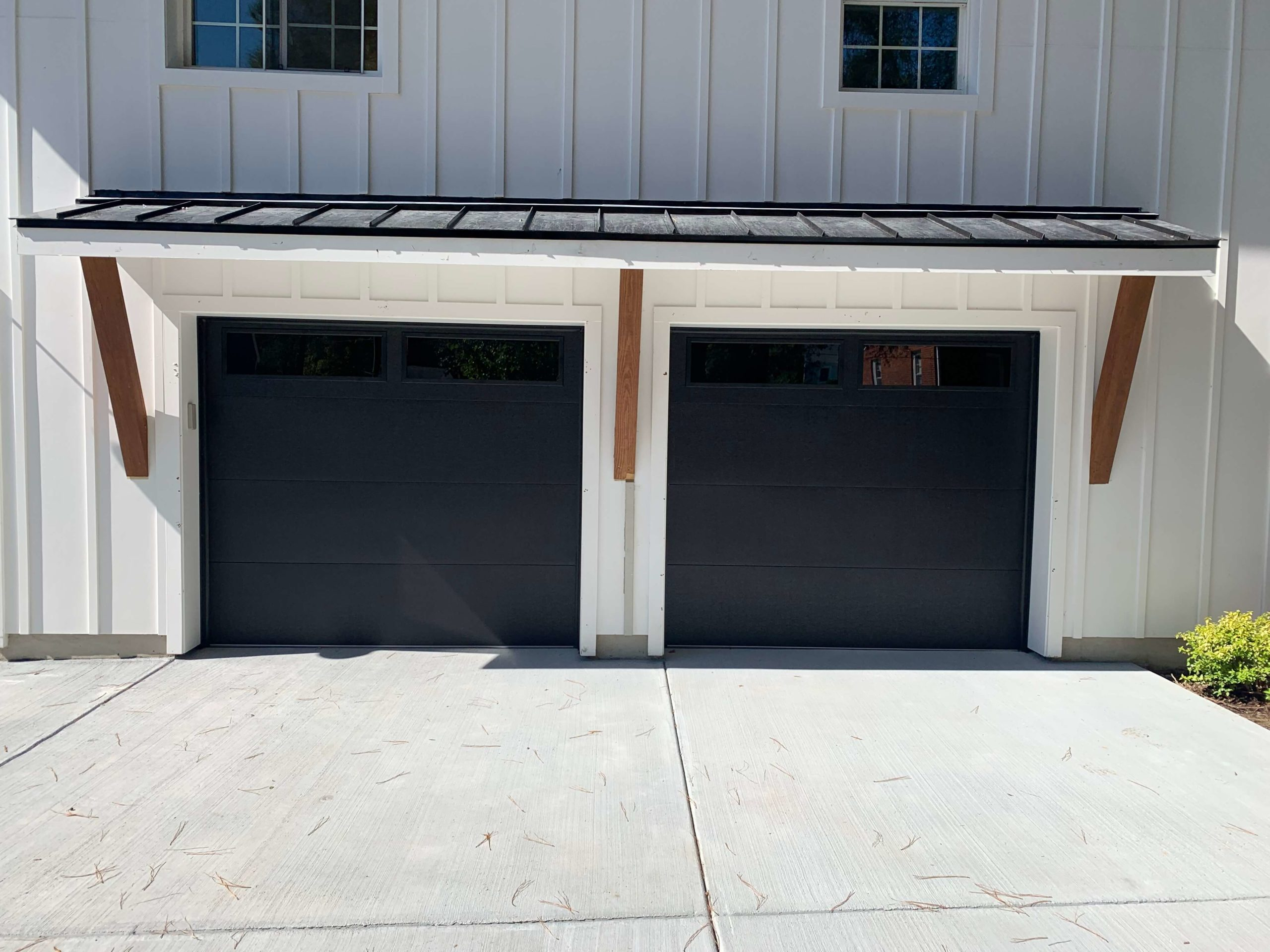 black flush garage door with plain glass