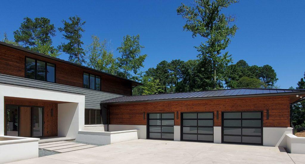 three full view glass garage doors