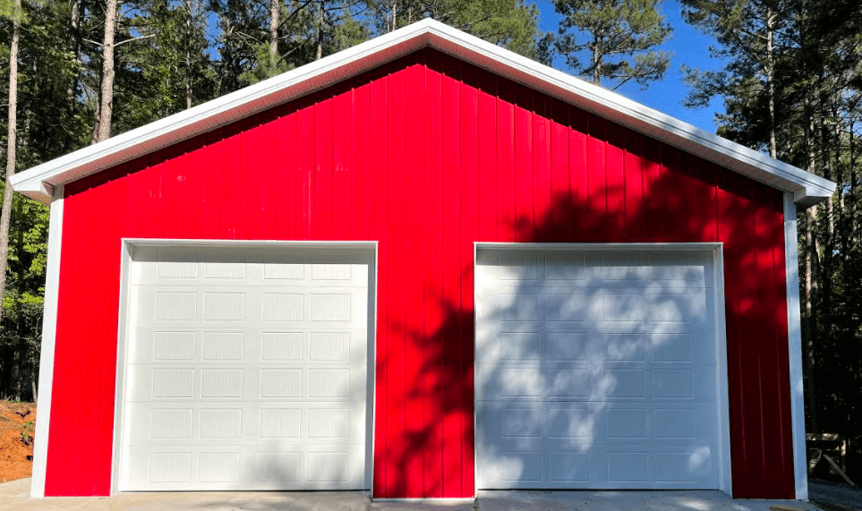white garage doors on red house